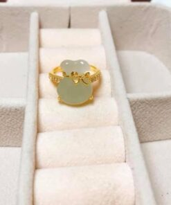 Nhãn túi tiền đá phong thủy vàng RIOGEMs