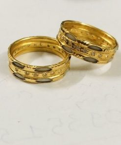 Cặp nhẫn vàng 18K luồng 2 lông trắng chạy 1 hàng đá Cz (lông FAKE)