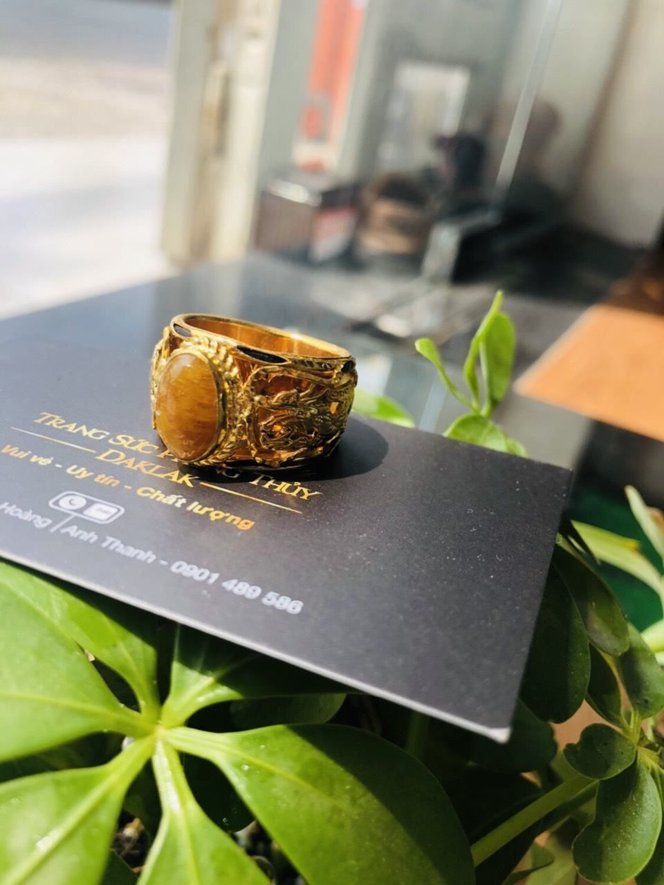 Nhẫn Rồng vàng 18K chầu ngọc Thạch Anh Tóc vàng phong thủy