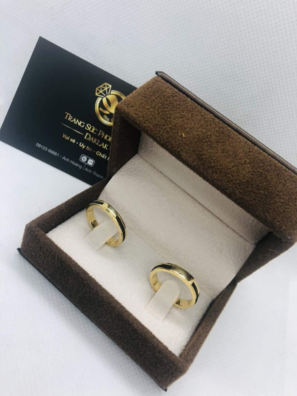 Nhẫn nam nữ làm tay 1 sợi vàng 18K xỏ 1 lông