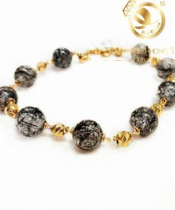 vong-tay-thach-anh-toc-den-mix-vang-phong-thuy-riogems
