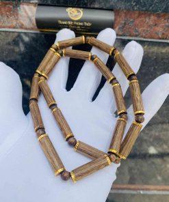 Dây chuyền gỗ trầm hương bọc vàng - Sản phẩm dành cho người mệnh HỎA và mệnh MỘC